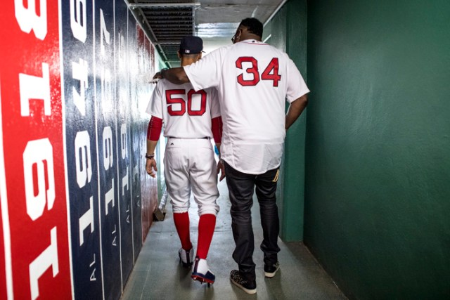 Former Boston Red Sox player David Ortiz walks through a hallway with Mookie Betts #50 of the Boston Red Sox before a 2007 World Series Champion team reunion before a game against the Kansas City Royals on July 30, 2017 at Fenway Park in Boston, Massachusetts.