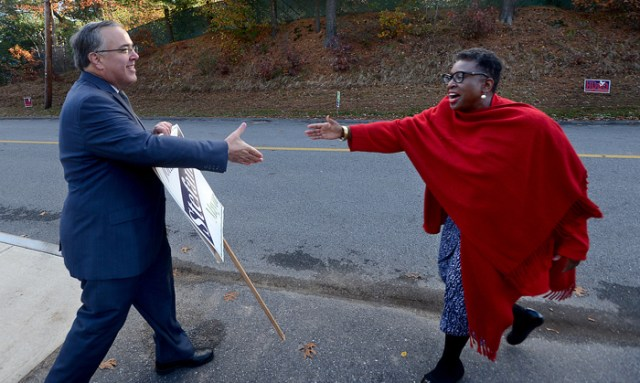 Opposing Framingham mayoral candidates John Stefanini, left, and Yvonne Spicer meet briefly to shake hands at the George King Elementary School polling station on election morning, Tuesday, Nov. 7.  Earlier in the year, Framingham voters decided to change its form of government from a town to a city.  Spicer won the election, making her Framingham's first mayor and the first African-American female elected mayor in Massachusetts.