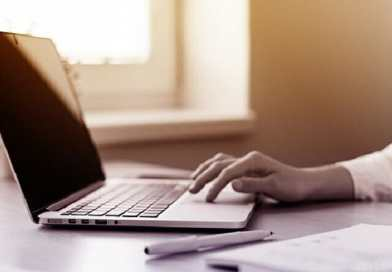 Woman Working On Laptop - Close-Up of Hands