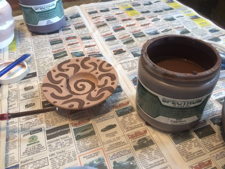 pre-fired image of piece showing Eggplant design over Antique Brown
