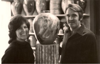 Mom and Dad with one of their Salt Glaze pots in the showroom of their studio
