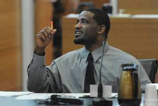 Everrick Houston sits in a Manatee County courtroom Monday during jury selection. Houston, 34, is charged with two counts of first-degree murder and one count armed burglary. GRANT JEFFERIES/Bradenton Herald