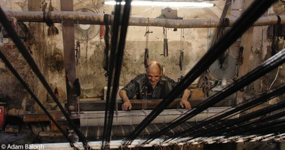 A traditional weaver in Kachan, Iran by Adam Balogh