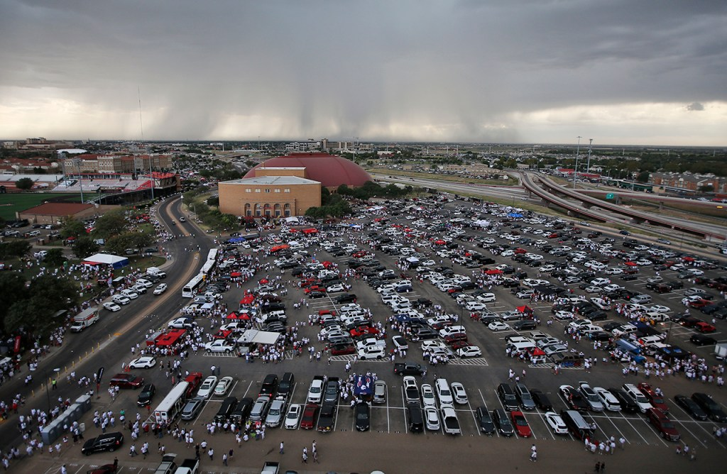 Fans evacuate the stadium during a weather delay before Texas Tech's game against Arizona State, Saturday, Sept. 16, 2017, at Jones AT&T Stadium in Lubbock, Texas. (Brad Tollefson/A-J Media)
