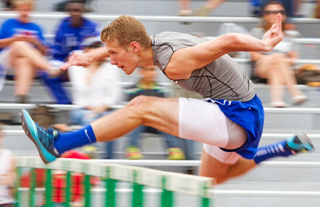 Frenship's Christian Carroll jumps over a hurdle during the 110M Hurdles at the UIL District 2-5A Track Championship on Friday, April 11, 2014, at Lowrey Field in Lubbock, Texas.