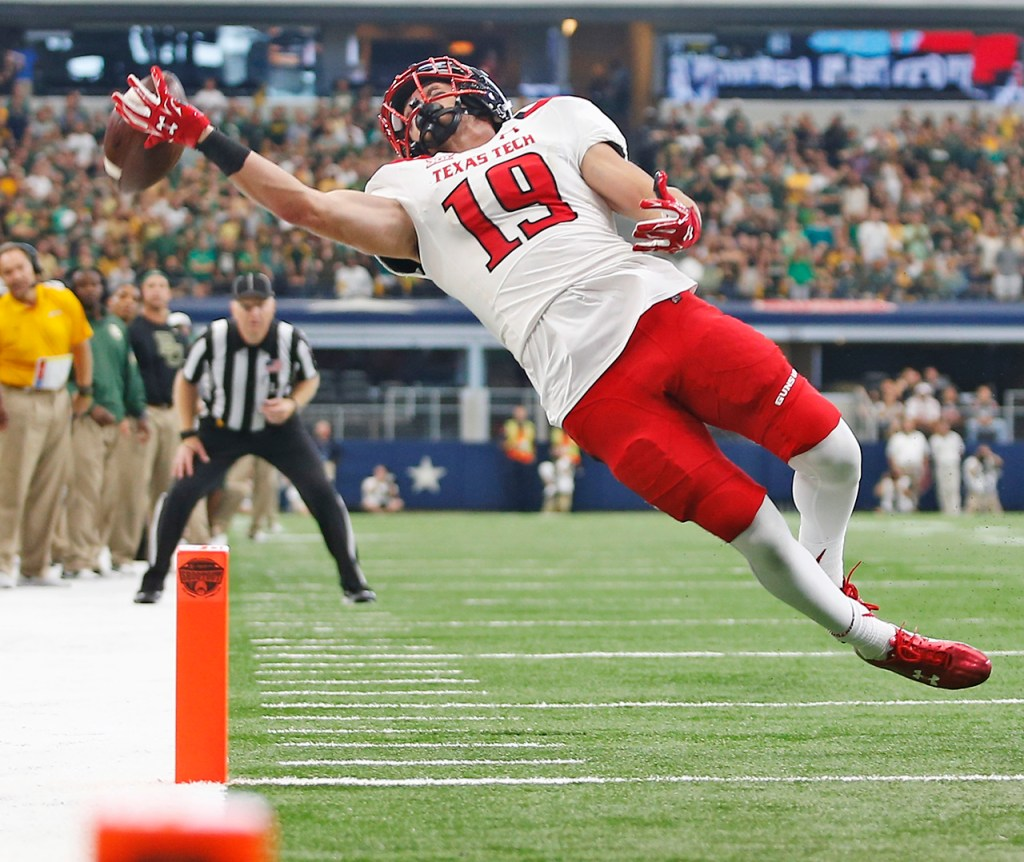 Texas Tech wide receiver Zach Austin stretches out trying to catch the ball during the Red Raiders' 63-35 loss against Baylor University on Saturday, Oct. 3, 2015, at AT&T Stadium in Arlington, Texas.