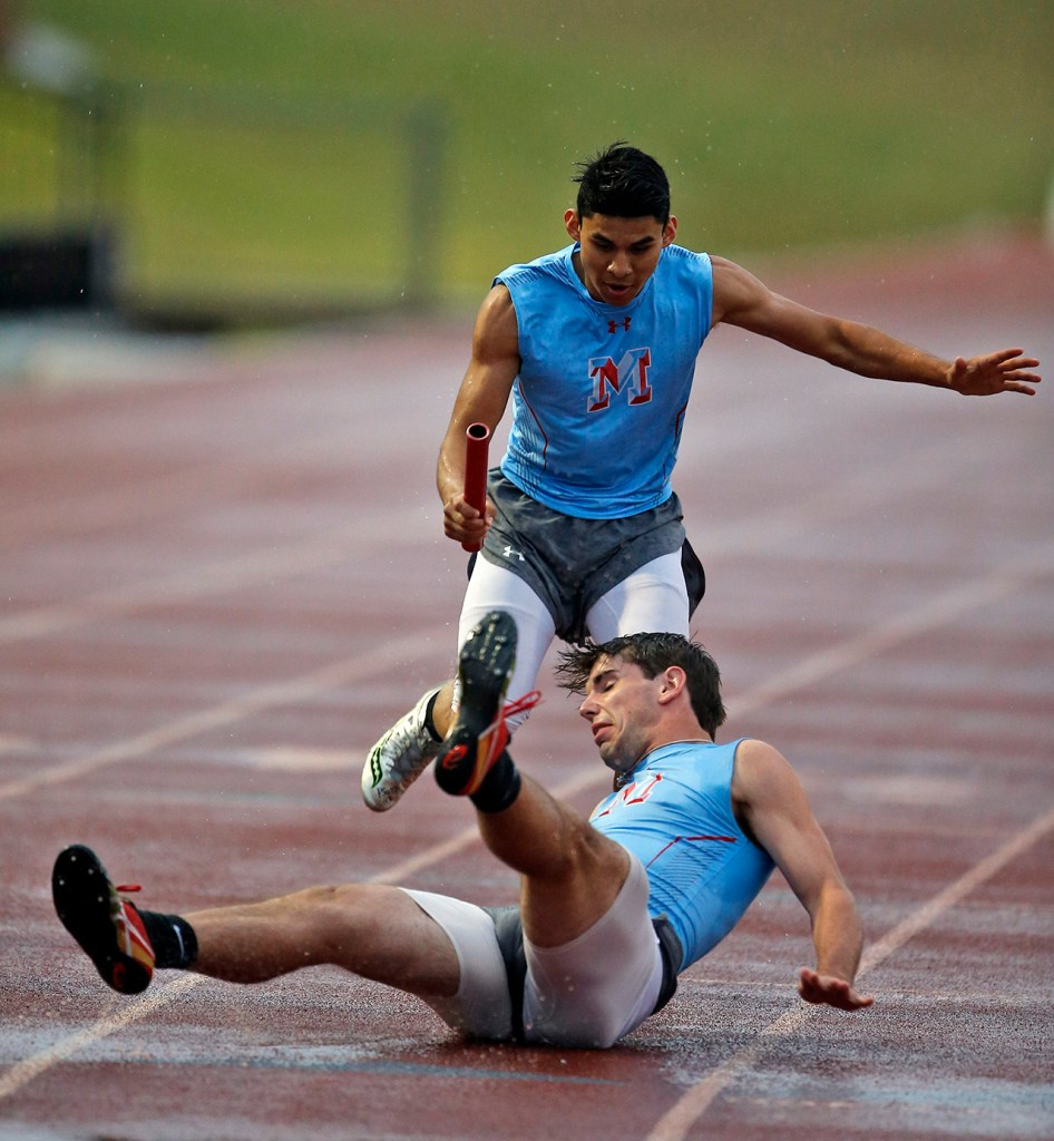 Monterey's Jack Dykes falls down before grabbing baton from Nicholas Villarreal during the first exchange in the 4x400 meter relay during the District 4-5A Track Meet, Wednesday, April 12, 2017, at PlainsCapital Park at Lowrey Field in Lubbock, Texas.