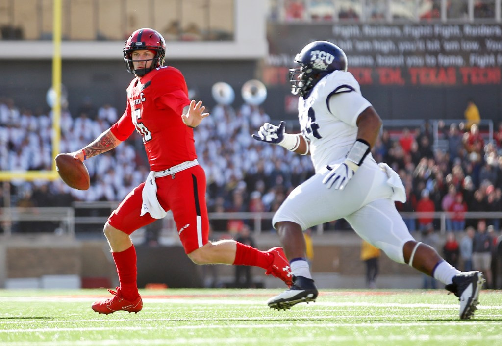 Texas Tech's Nic Shimonek runs away from TCU's Joseph Broadnax Jr.