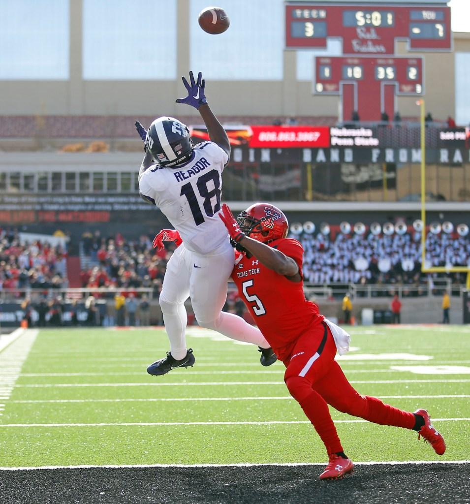 TCU's Jalen Reagor jumps to catch the pass over Texas Tech's Octavious Morgan