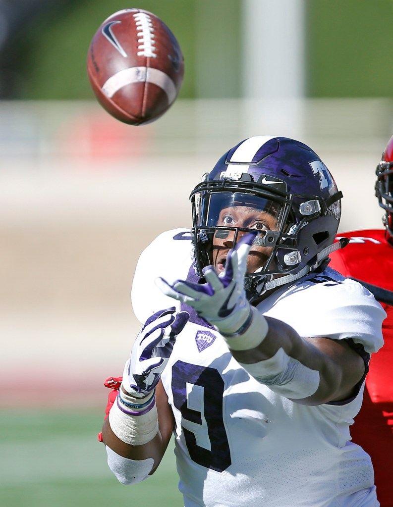 TCU's John Diarse reaches out to catch the ball but misses the pass