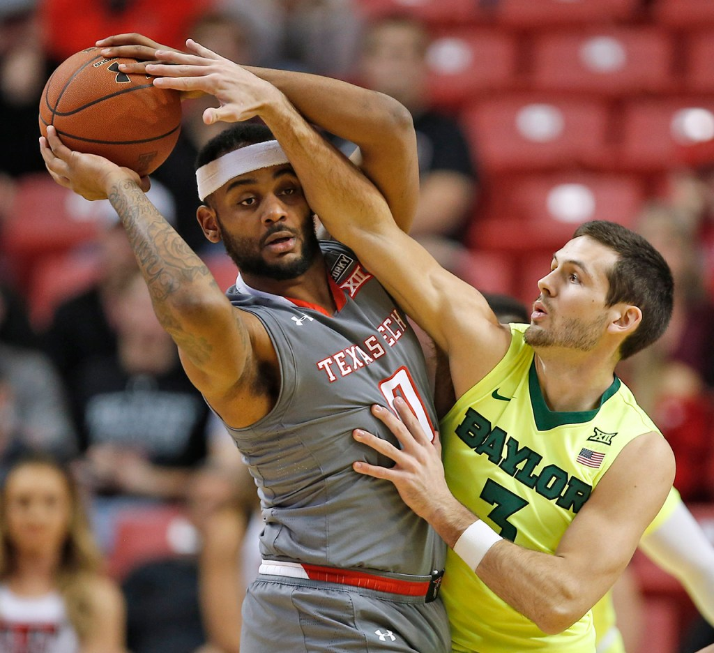 Baylor's Jake Lindsey (3) tries to keep Texas Tech's Tommy Hamilton (0) from passing the ball during the first half of an NCAA college basketball game Friday, Dec. 29, 2017, in Lubbock, Texas. (AP Photo/Brad Tollefson)