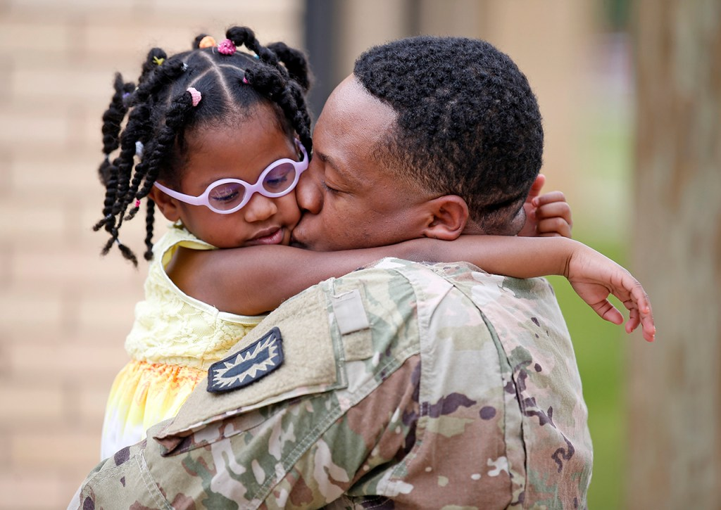 Joshua McKee hugs his daughter Zoey after surprising his children during a class presentation Thursday, April 27, 2017, at Wheelock Elementary in Lubbock, Texas. Spc. McKee returned home after being stationed in Iraq with the Army. (Brad Tollefson/A-J Media)
