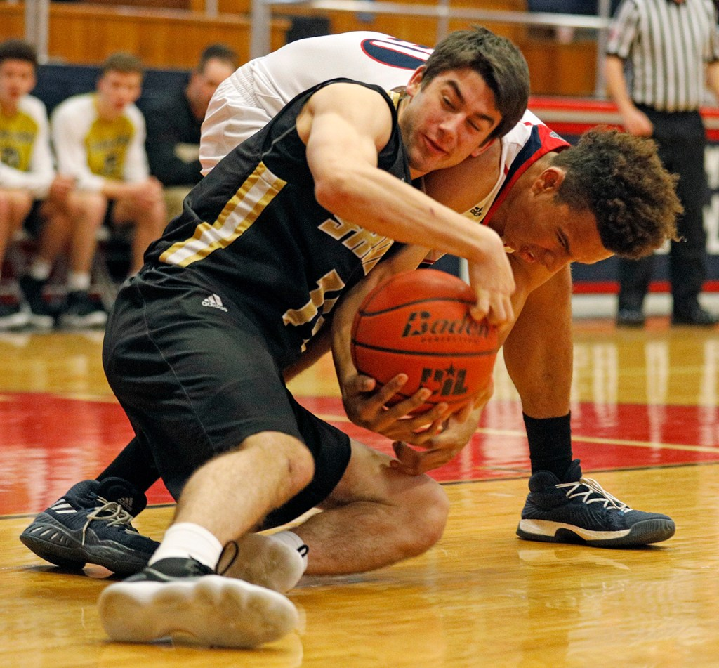 Amarillo's Cooper McLain (14) tries to steal the ball from Plainview's Josh Thomas (40) during the game Tuesday, Jan. 2, 2018, in Plainview, Texas. (Brad Tollefson/A-J Media)