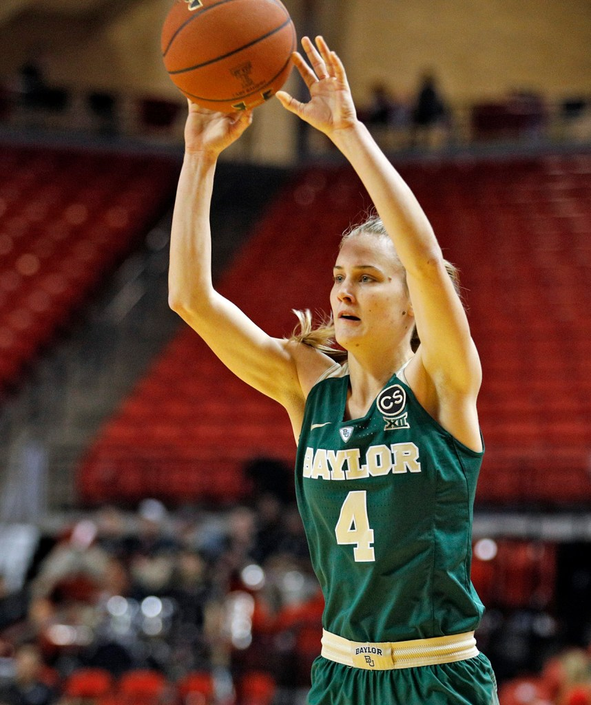 Baylor's Kristy Wallace (4) passes the ball during an NCAA college basketball game against Texas Tech, Saturday, Feb. 3, 2018, in Lubbock, Texas. (AP Photo/Brad Tollefson)