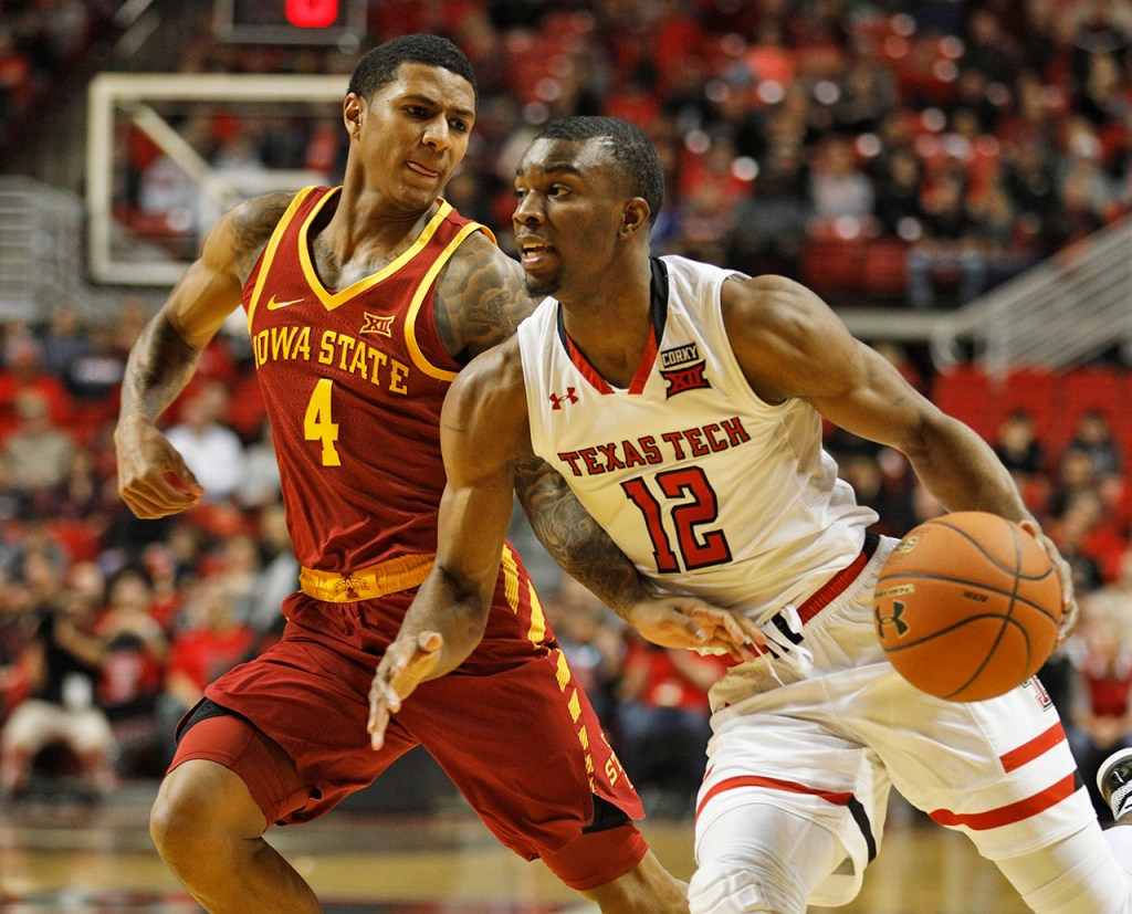 Iowa State's Donovan Jackson (4) tries to steal the ball from Texas Tech's Keenan Evans (12) during an NCAA college basketball game Wednesday, Feb. 7, 2018, in Lubbock, Texas. (AP Photo/Brad Tollefson)