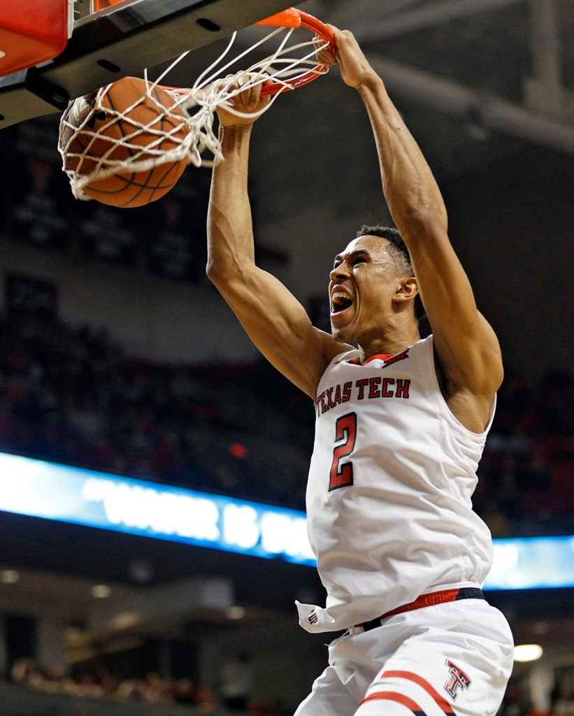 Texas Tech's Zhaire Smith (2) dunks the ball during an NCAA college basketball game Saturday, March 3, 2018 in Lubbock, Texas. (AP Photo/Brad Tollefson)