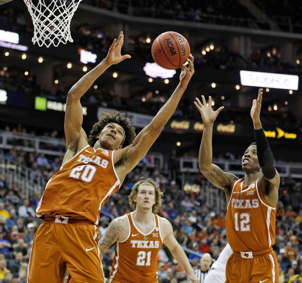 Texas' Jericho Sims (20) rebounds the ball during a Big 12 basketball tournament game against Texas Tech, Thursday, March 8, 2018, at the Sprint Center in Kansas City, Mo. [Brad Tollefson/A-J Media]