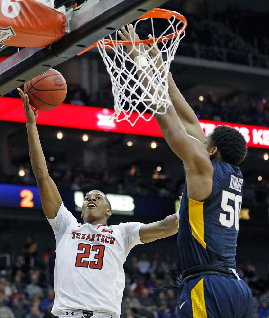 Texas Tech's Jarrett Culver (23) lays up the ball around West Virginia's Sagaba Konate (50) during a Big 12 semifinal game Friday, March 9, 2018, at the Sprint Center in Kansas City, Mo. [Brad Tollefson/A-J Media]