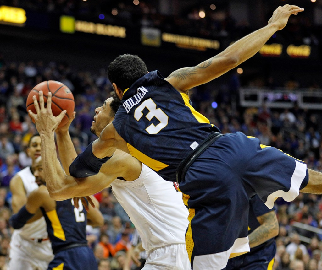 Texas Tech's Zach Smith (11) shoots the ball as he's fouled by West Virginia's James Bolden (3) during a Big 12 semifinal game Friday, March 9, 2018, at the Sprint Center in Kansas City, Mo. [Brad Tollefson/A-J Media]