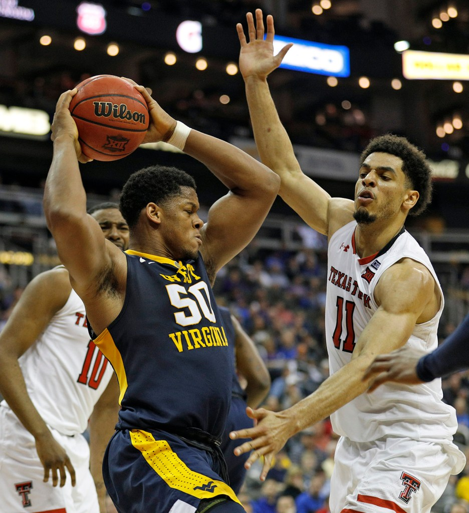 West Virginia's Sagaba Konate (50) tries to pass the ball around Texas Tech's Zach Smith (11) during a Big 12 semifinal game Friday, March 9, 2018, at the Sprint Center in Kansas City, Mo. [Brad Tollefson/A-J Media]
