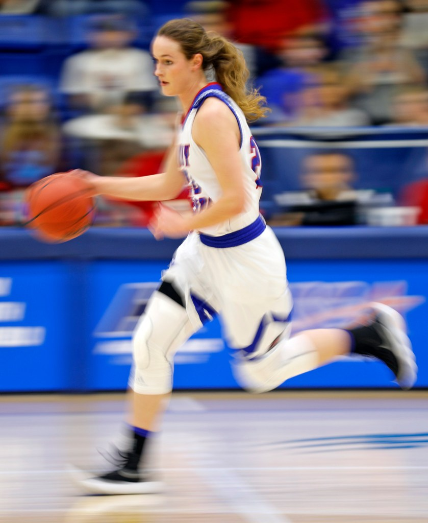 Lubbock Christian's Olivia Robertson (20) dribbles the ball down the court during the South Central regional championship against West Texas A&M, Monday, March 12, 2018, at Rip Griffin Center in Lubbock, Texas. [Brad Tollefson/A-J Media]