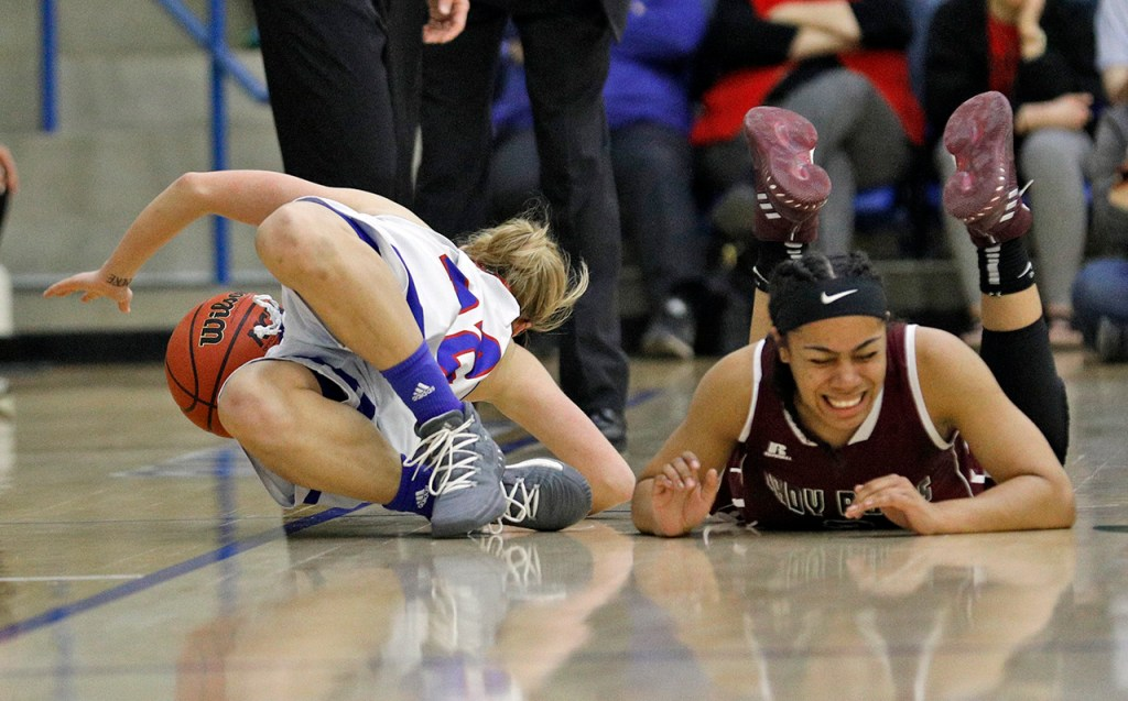 Lubbock Christian's Delaney Gaddis (32) falls out of bounds trying to get the loose ball from West Texas A&M's Deleyah Harris (2) during the South Central regional championship Monday, March 12, 2018, at Rip Griffin Center in Lubbock, Texas. [Brad Tollefson/A-J Media]