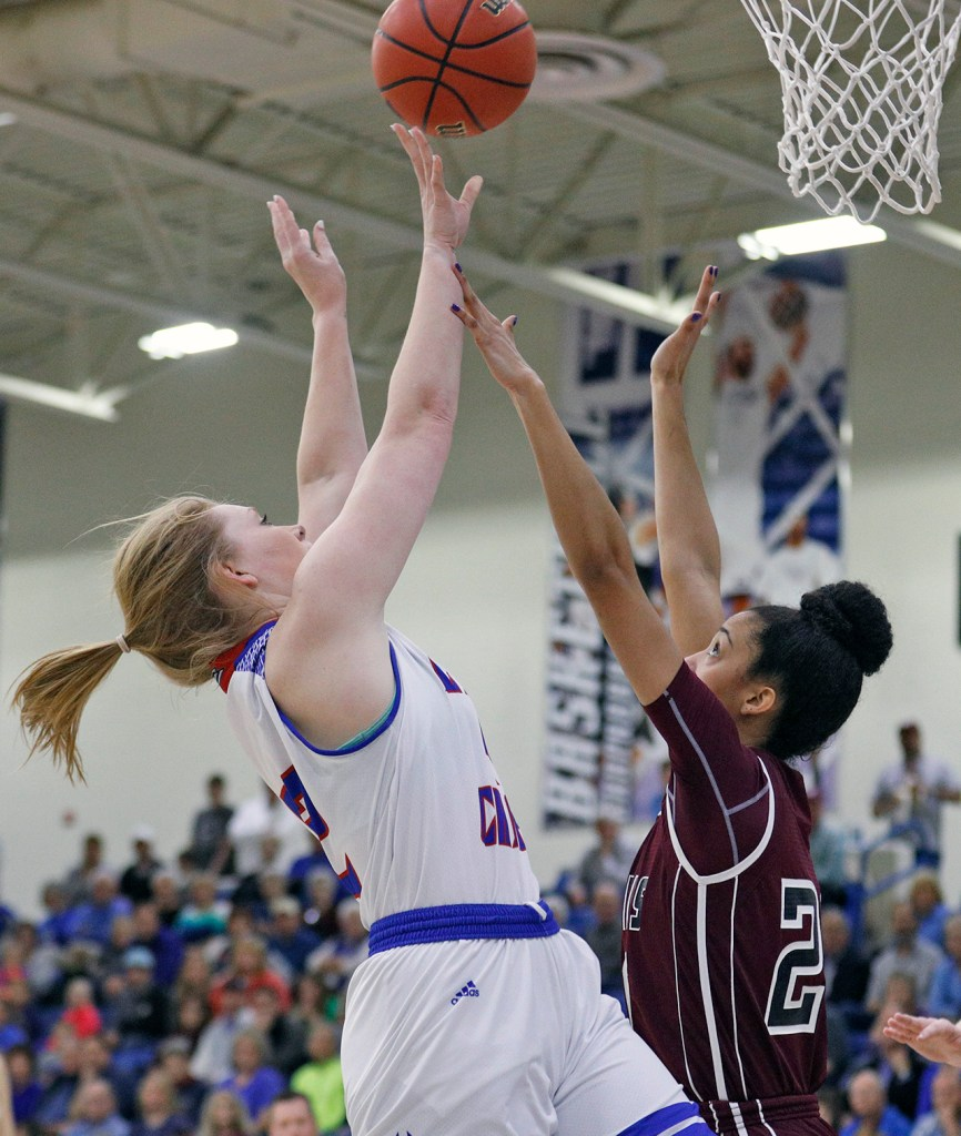 Lubbock Christian's Bobbi Chitsey (42) shoots the ball over West Texas A&M's Tiana Parker (20) during the South Central regional championship Monday, March 12, 2018, at Rip Griffin Center in Lubbock, Texas. [Brad Tollefson/A-J Media]