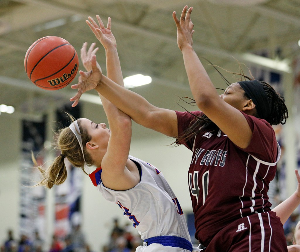 Lubbock Christian's Delaney Gaddis (32) shoots the ball as it's blocked by West Texas A&M's Tyesha Taylor (41) during the South Central regional championship Monday, March 12, 2018, at Rip Griffin Center in Lubbock, Texas. [Brad Tollefson/A-J Media]