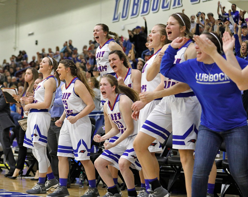Lubbock Christian players celebrate during the South Central regional championship against West Texas A&M, Monday, March 12, 2018, at Rip Griffin Center in Lubbock, Texas. [Brad Tollefson/A-J Media]