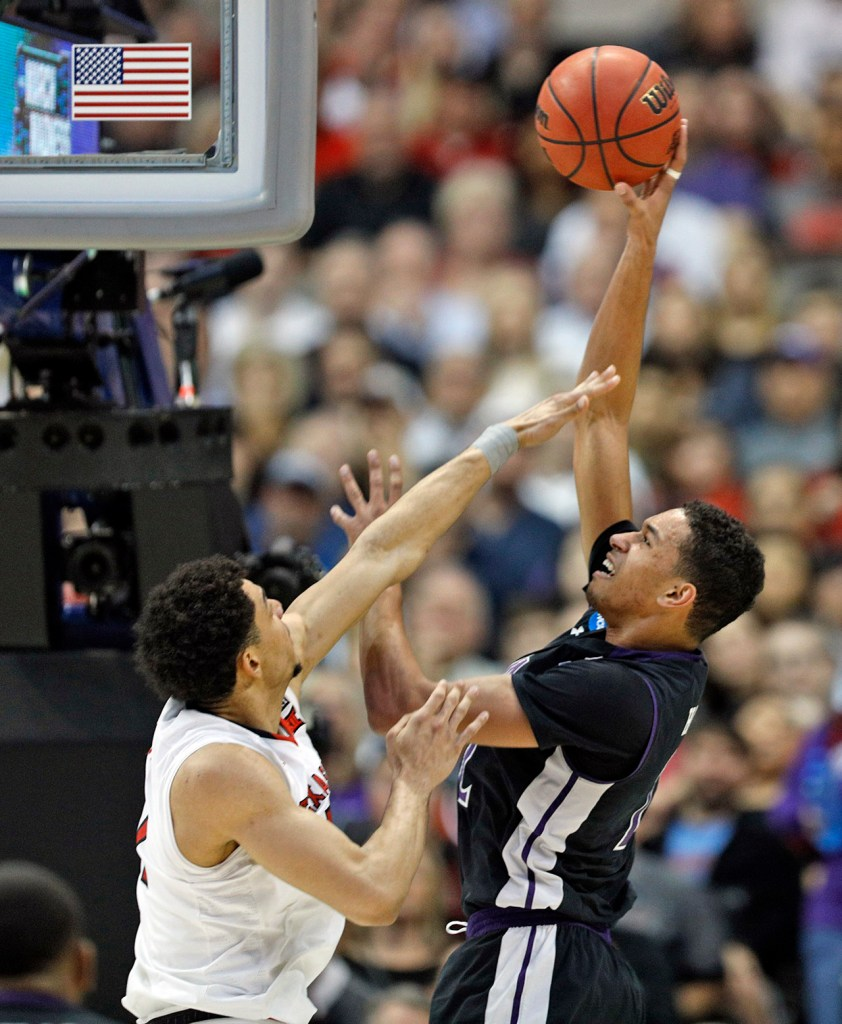 Texas Tech's Zach Smith (11) tries to block the shot by Stephen F. Austin's TJ Holyfield (22) during an NCAA college basketball tournament first-round game Thursday, March 15, 2018, at American Airlines Center in Dallas, Texas. [Brad Tollefson/A-J Media]