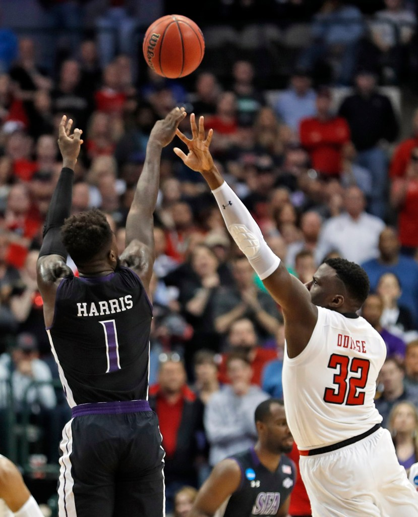 Stephen F. Austin's Kevon Harris (1) shoots the ball over Texas Tech's Norense Odiase (32) during an NCAA college basketball tournament first-round game Thursday, March 15, 2018, at American Airlines Center in Dallas, Texas. [Brad Tollefson/A-J Media]