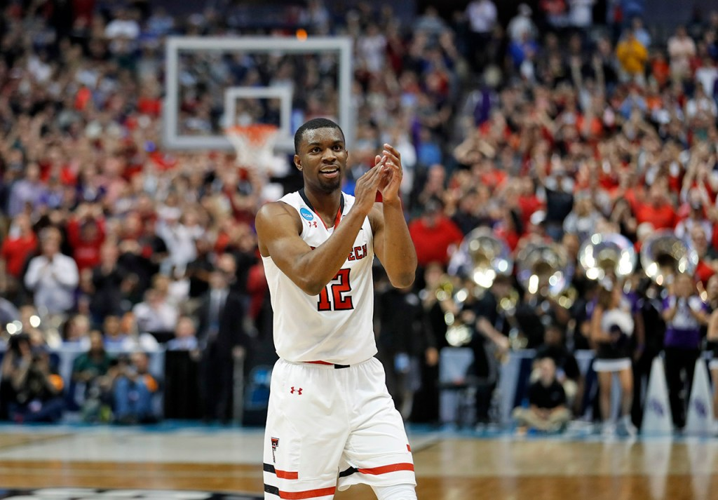 Texas Tech's Keenan Evans (12) celebrates after an NCAA college basketball tournament first-round game against Stephen F. Austin, Thursday, March 15, 2018, at American Airlines Center in Dallas, Texas. [Brad Tollefson/A-J Media]
