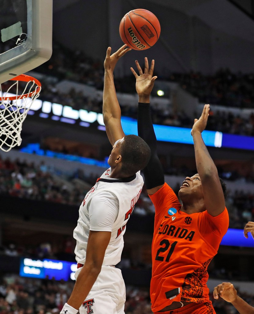 Texas Tech's Jarrett Culver (23) lays up the ball around Florida's Dontay Bassett (21) during an NCAA college basketball tournament second-round game Saturday, March 17, 2018 at American Airlines Center in Dallas, Texas. [Brad Tollefson/A-J Media]