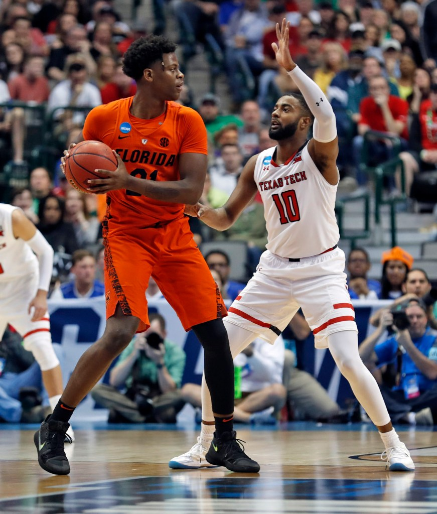Florida's Dontay Bassett (21) tries to pass the ball around Texas Tech's Niem Stevenson (10) during an NCAA college basketball tournament second-round game Saturday, March 17, 2018 at American Airlines Center in Dallas, Texas. [Brad Tollefson/A-J Media]