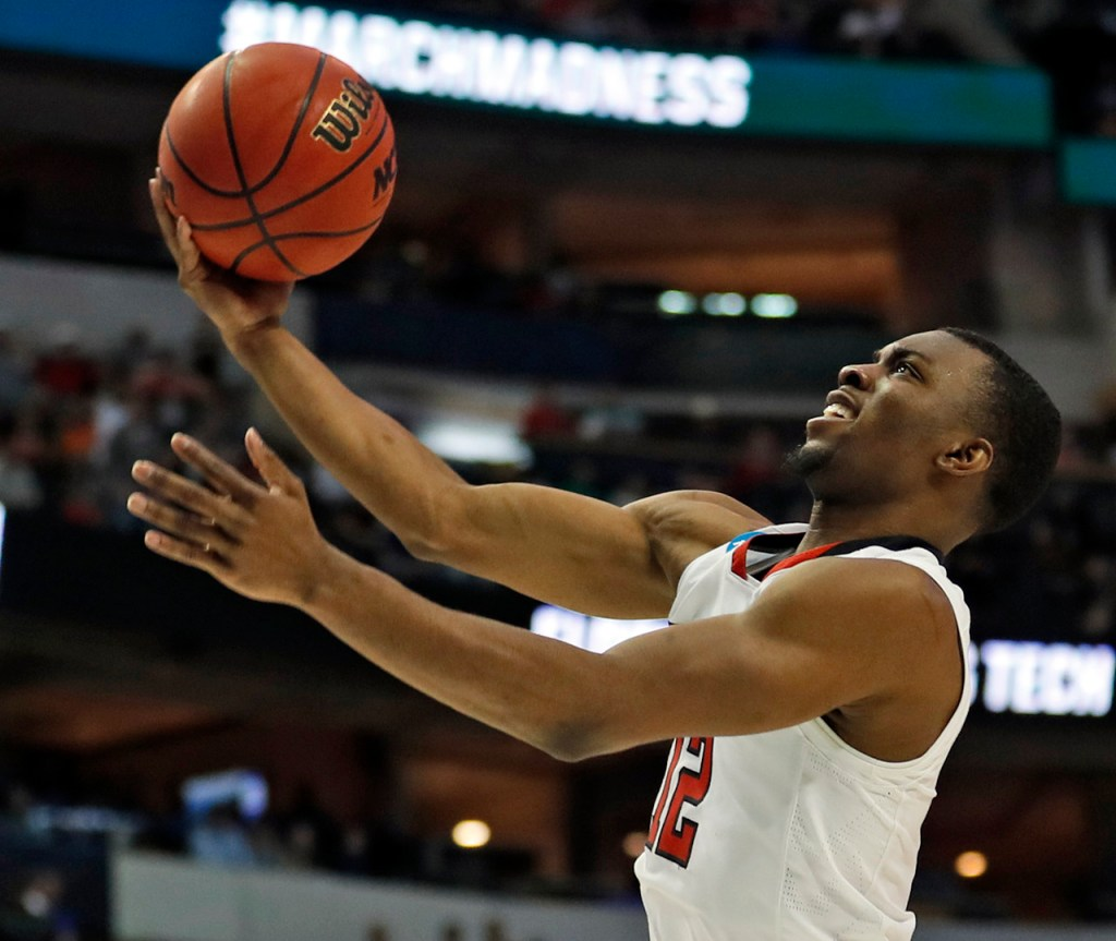 Texas Tech's Keenan Evans (12) lays up the ball during an NCAA college basketball tournament second-round game Saturday, March 17, 2018 at American Airlines Center in Dallas, Texas. [Brad Tollefson/A-J Media]