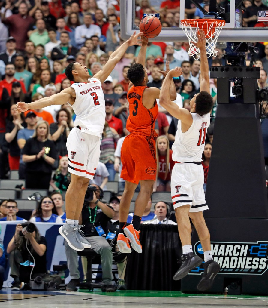 Texas Tech's Zhaire Smith (2) and Zach Smith (11) try to block the shot by Florida's Jalen Hudson (3) during an NCAA college basketball tournament second-round game Saturday, March 17, 2018 at American Airlines Center in Dallas, Texas. [Brad Tollefson/A-J Media]