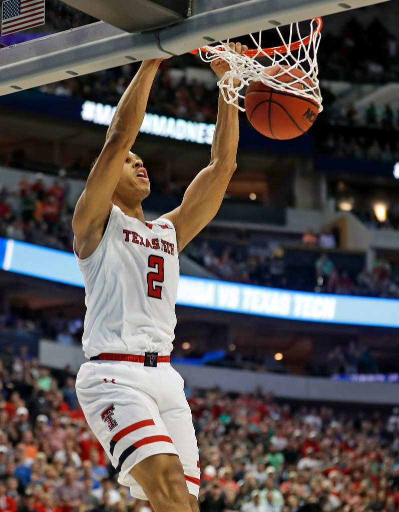 Texas Tech's Zhaire Smith (2) dunks the ball during an NCAA college basketball tournament second-round game Saturday, March 17, 2018, at American Airlines Center in Dallas, Texas. [Brad Tollefson/A-J Media]