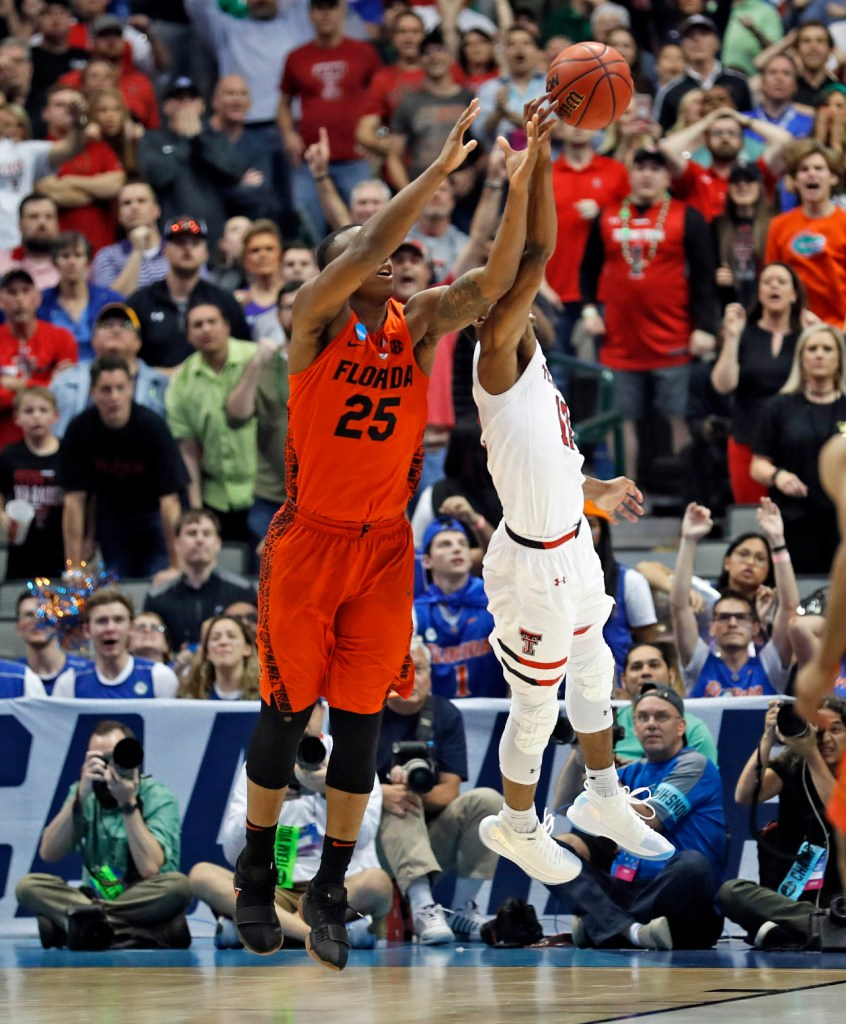 Texas Tech's Keenan Evans (12) tries to knock the ball away from Florida's Keith Stone (25) during an NCAA college basketball tournament second-round game Saturday, March 17, 2018 at American Airlines Center in Dallas, Texas. [Brad Tollefson/A-J Media]