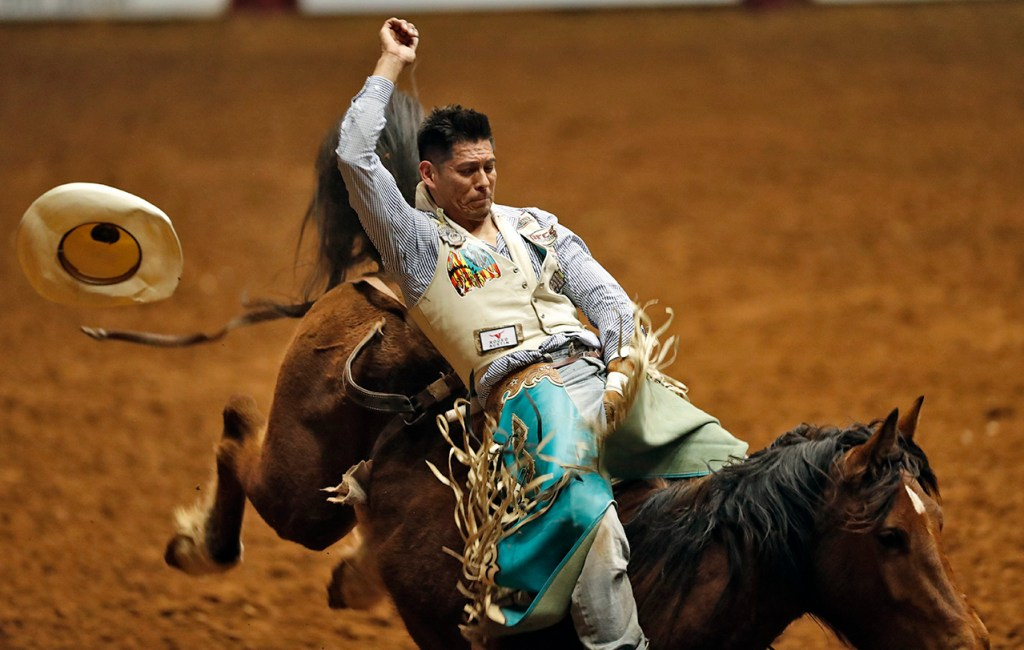 Kyle Charley (44) competes in the bareback riding competition during the ABC Pro Rodeo, Thursday, March 29, 2018, at Municipal Coliseum in Lubbock, Texas. [Brad Tollefson/A-J Media]
