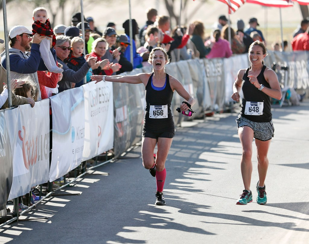Alex Miller (656) and Reagan Alexander (648) finish the half marathon race during the Mayor's Marathon, Sunday, April 22, 2018, in Lubbock, Texas. [Brad Tollefson/A-J Media]