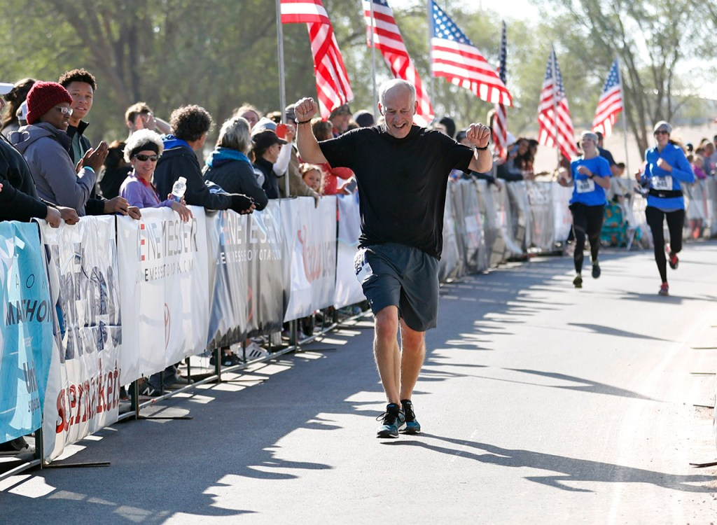 Mayor Dan Pope finishes the half marathon race during the Mayor's Marathon, Sunday, April 22, 2018, in Lubbock, Texas. [Brad Tollefson/A-J Media]