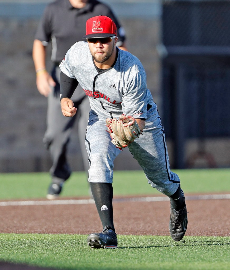 Louisville's Justin Lavey (16) fields a ground ball during an NCAA college baseball tournament regional game against Texas Tech, Saturday, June 2, 2018, in Lubbock, Texas. [Brad Tollefson/A-J Media]