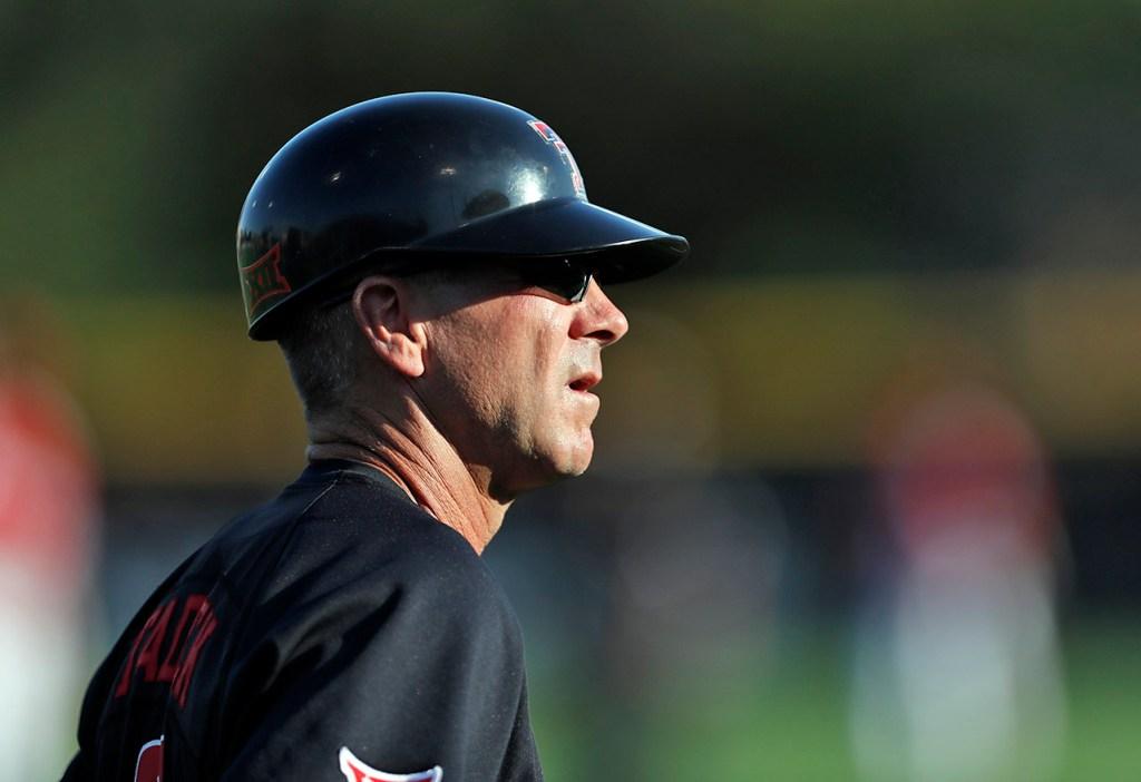 Texas Tech coach Tim Tadlock watches his team during an NCAA college baseball tournament regional game against Louisville, Sunday, June 3, 2018, in Lubbock, Texas. [Brad Tollefson/A-J Media]