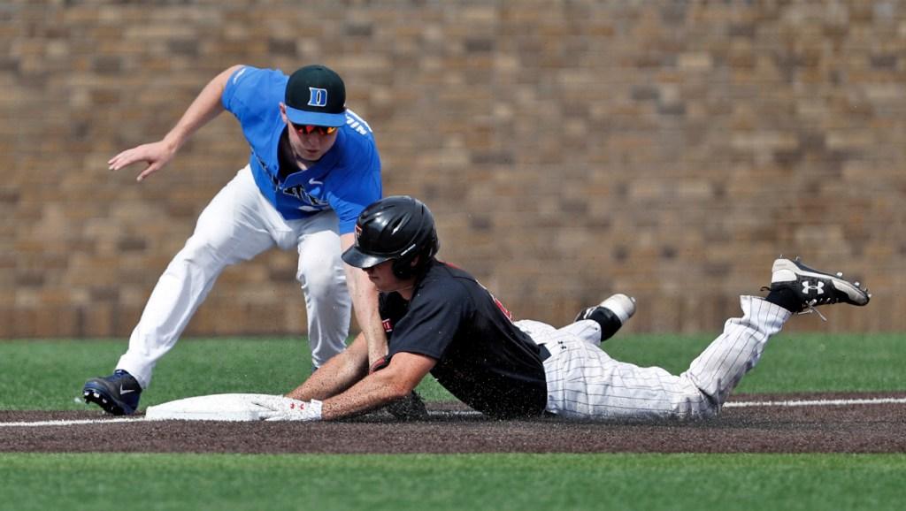 Duke's Erikson Nichols (42) tags out Texas Tech's Braxton Fulford (26) as he slides into third base during an NCAA college baseball tournament super regional game Saturday, June 9, 2018, in Lubbock, Texas. [Brad Tollefson/A-J Media]