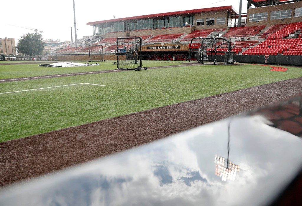 Weather causes a delay before an NCAA college baseball tournament super regional game between Texas Tech and Duke, Sunday, June 10, 2018, in Lubbock, Texas. [Brad Tollefson/A-J Media]