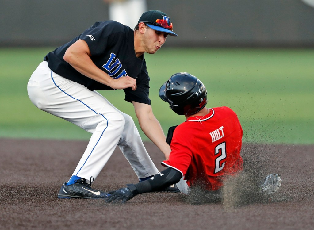 Duke's Zack Kone (2) tags out Texas Tech's Gabe Holt (2) as he slides into second base during an NCAA college baseball tournament super regional game Sunday, June 10, 2018, in Lubbock, Texas. [Brad Tollefson/A-J Media]