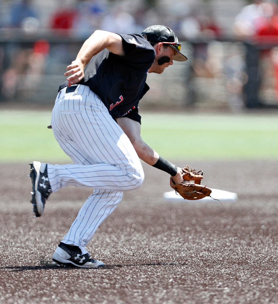 Texas Tech's Michael Davis (3) grabs a ground ball during an NCAA college baseball tournament super regional game Monday, June 11, 2018, in Lubbock, Texas. [Brad Tollefson/A-J Media]