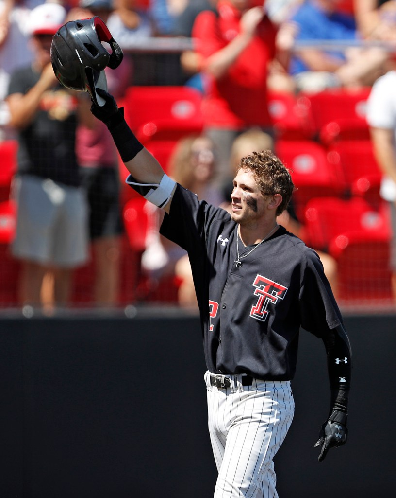 Texas Tech's Gabe Holt (2) holds up his helmet after hitting a home run during an NCAA college baseball tournament super regional game against Duke, Monday, June 11, 2018, in Lubbock, Texas. [Brad Tollefson/A-J Media]
