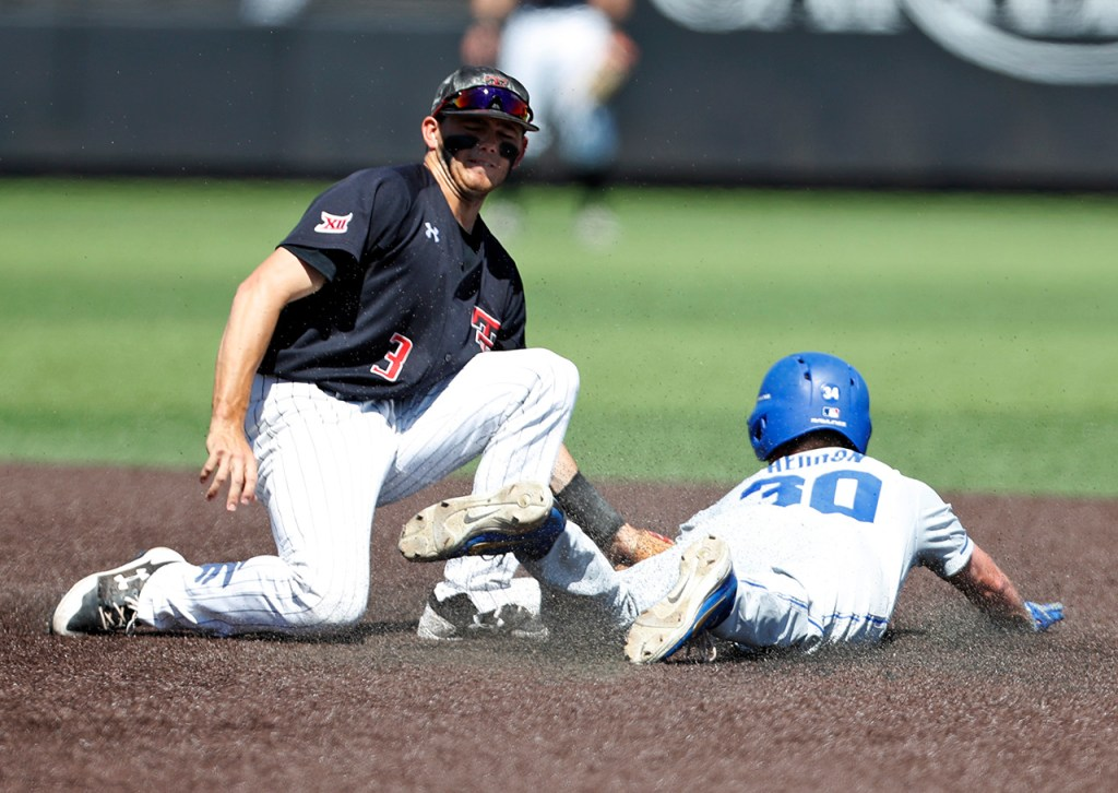 Texas Tech's Michael Davis (3) tags out Duke's Jimmy Herron (30) as he slides into second base during an NCAA college baseball tournament super regional game Monday, June 11, 2018, in Lubbock, Texas. [Brad Tollefson/A-J Media]