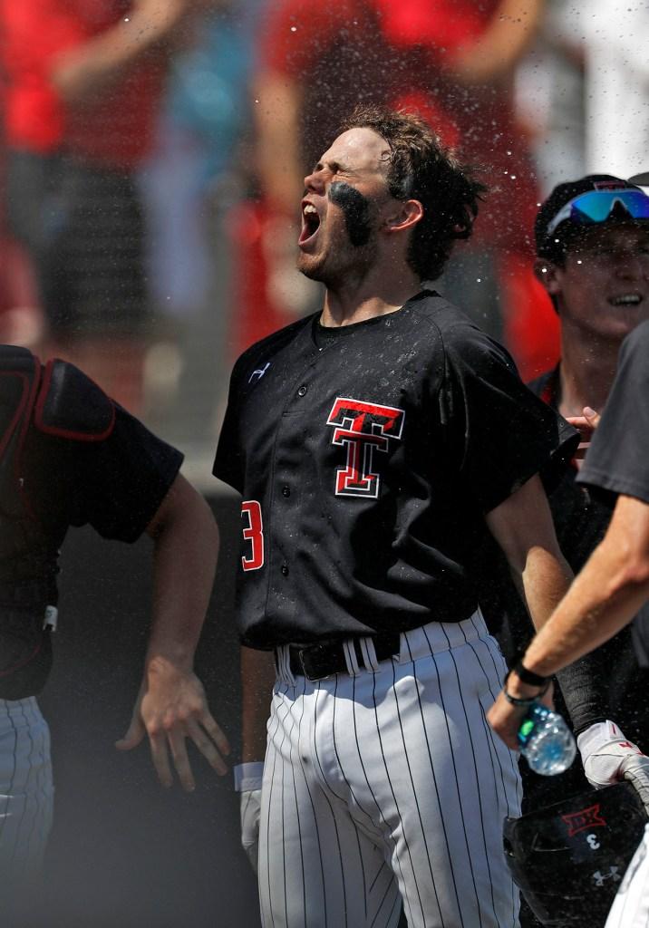Texas Tech's Michael Davis (3) celebrates after hitting a home run during an NCAA college baseball tournament super regional game against Duke, Monday, June 11, 2018, in Lubbock, Texas. [Brad Tollefson/A-J Media]